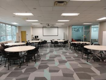 The Digital Scholarship Lab Flex Space with round tables and chairs