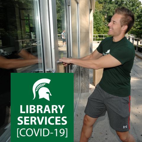 Photo of student trying to open library door, which is locked.