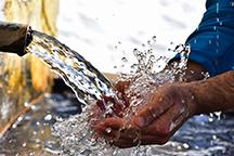 Water flowing into cupped hands